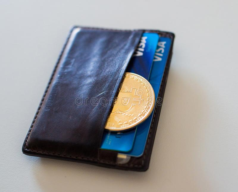 Bitcoin coin in the wallet stock photo