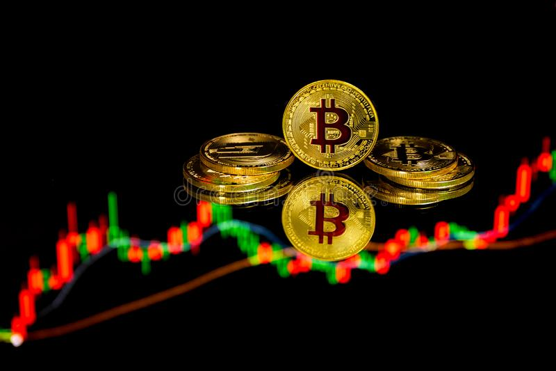 Bitcoin coins with global trading exchange market price chart in the background. Bitcoin and cryptocurrency investing concept - Physical metal Bitcoin coins with royalty free illustration