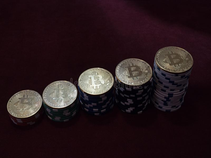 Bitcoin coins on poker chips. The ladder of financial growth. The concept of replacement bitcoin in all forms of payment stock photography