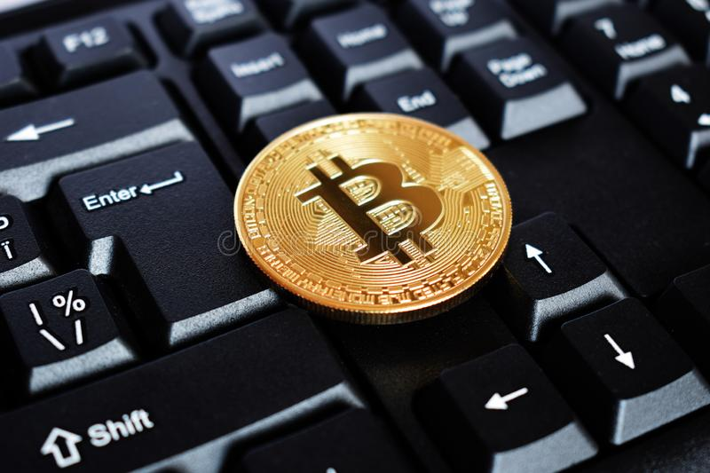 Bitcoin on compuer keyboard in background, symbol of electronic virtual money and mining cryptocurrency concept. Coin crypto stock photos