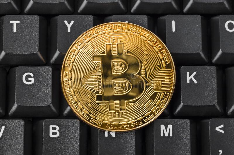 Bitcoin and computer - business background stock image