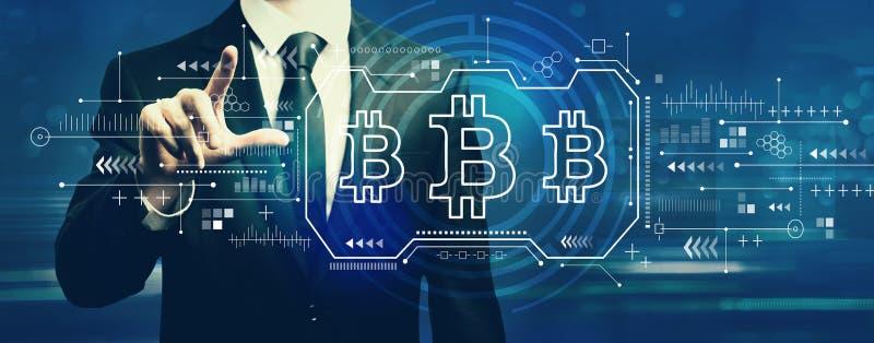 Bitcoin con el hombre de negocios fotografía de archivo libre de regalías