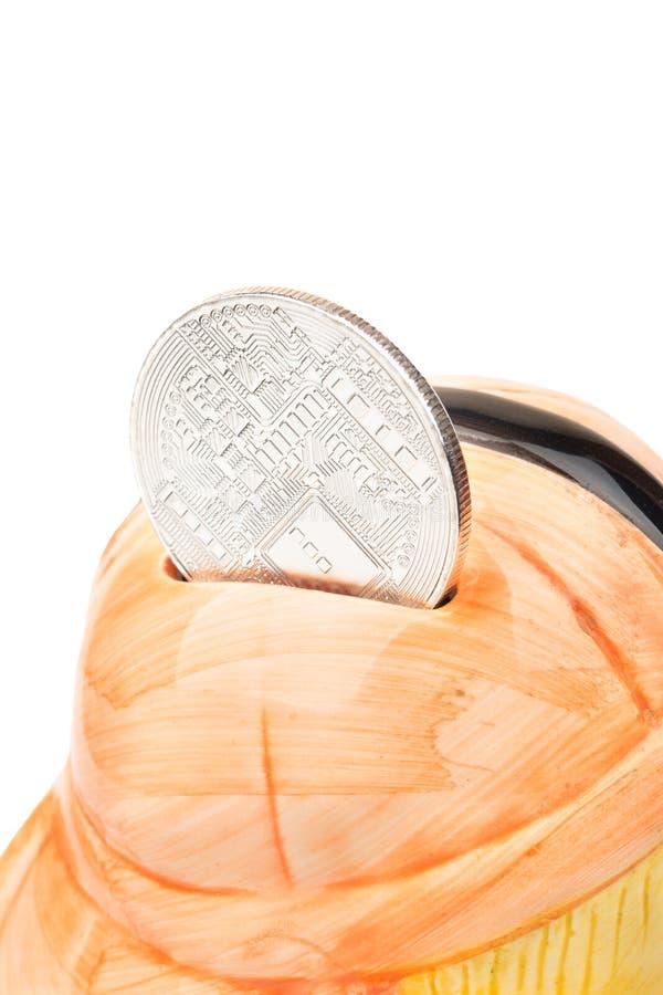 Bitcoin con la hucha fotografía de archivo