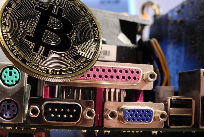 Bitcoin con la placa madre imagen de archivo libre de regalías