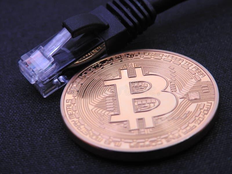 Bitcoin con un enchufe rj-45 imagenes de archivo