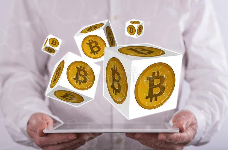 Concept of bitcoin. Bitcoin concept above a tablet held by a man in background royalty free stock image