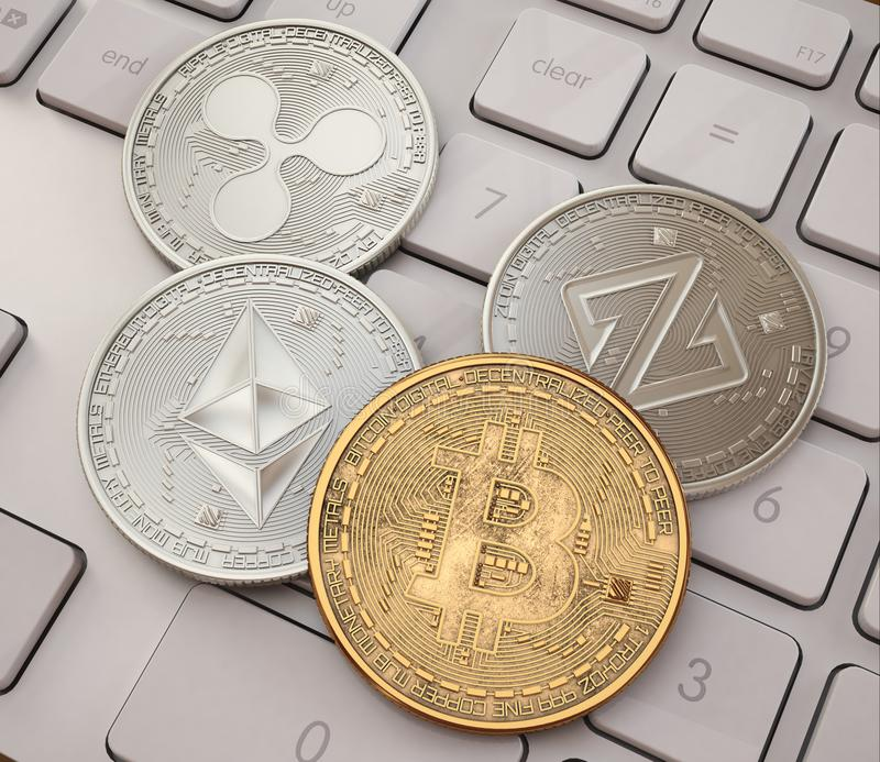 Bitcoin. Cripto bit coin. Digital currency. Cryptocurrency. Golden physical coins with bitcoins on white stock photography
