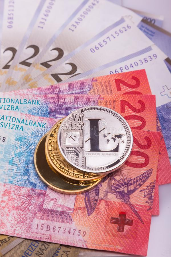 Bitcoin crypto currency coin over swiss francs bank notes royalty free stock photo
