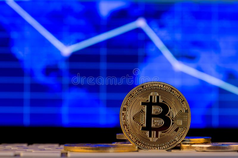 Bitcoin crypto currency falls down concept. Virtual currency on the trends graph background. Cash, digital, electronic, money, net, pay, payment, ripple royalty free stock photography