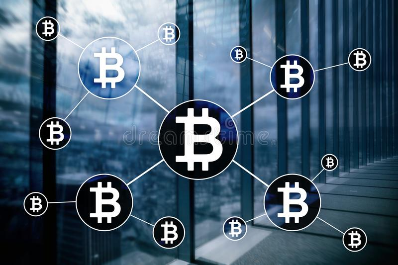 Bitcoin cryptocurrency and blockchain technology concept on blurred skyscrapers background royalty free stock photography