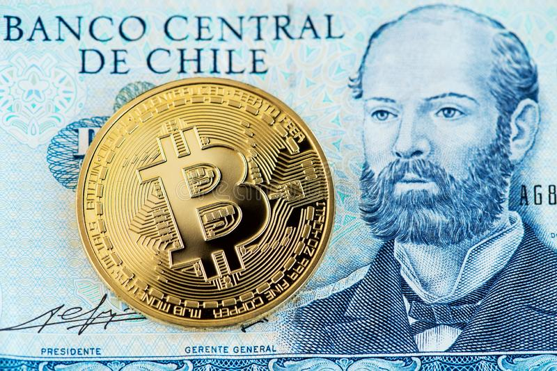 Bitcoin Cryptocurrency with Chilean pesos banknote. Bitcoin and Chilean money pesos. royalty free stock images