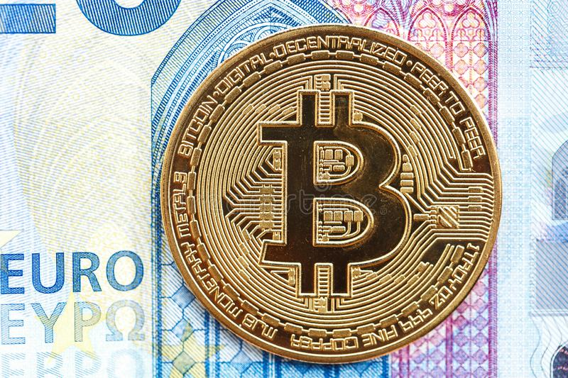 Bitcoin cryptocurrency coin lies on a 20 euro bill stock image