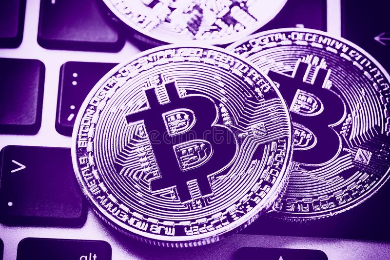 Download Bitcoin Cryptocurrency Coins On Laptop Keyboard. Close Up Ultraviolet Toned Stock Photo - Image of circle, electronic: 112586650