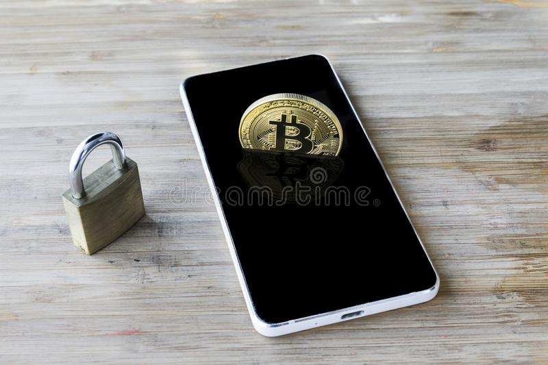 Bitcoin Cryptocurrency Digital Bit Coin BTC Currency Technology Business Internet Concept. Bitcoin over smartphone stock photos
