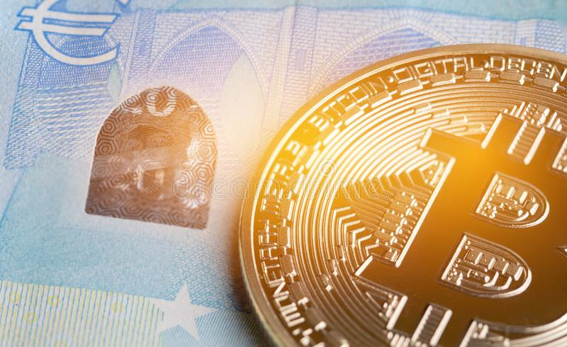 Bitcoin Cryptocurrency is Digital payment money Concept, Gold coins with B letter symbol,electronic circuit on EURO EYP20 bill. Cryptocurrency can uses designed royalty free stock photos