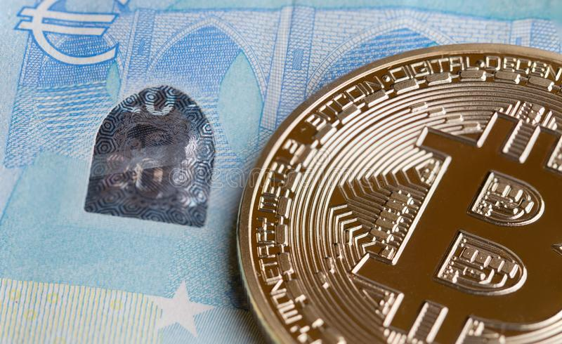 Bitcoin Cryptocurrency is Digital payment money Concept, Gold coins with B letter symbol,electronic circuit on EURO EYP20 bill. Cryptocurrency can uses designed stock photography
