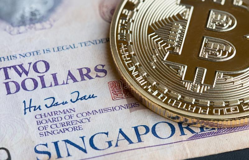 Bitcoin Cryptocurrency is Digital payment money, Gold coins with B letter symbol electronic circuit on Singapore bill. Cryptocurrency can uses designed,Business royalty free stock photos