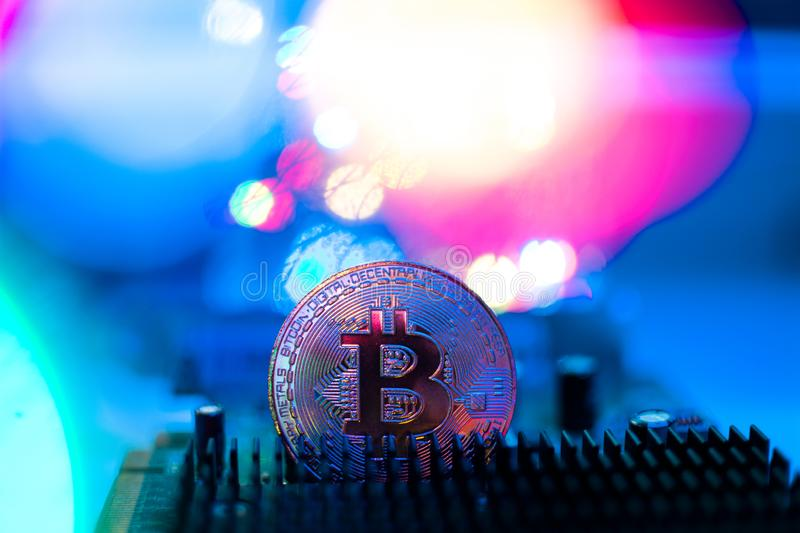 Bitcoin/Cryptocurrency e luci + elettronica fotografia stock
