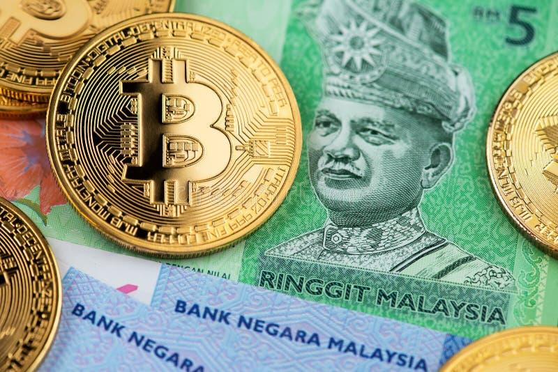 Bitcoin Cryptocurrency en Ringgit van Maleisië munt stock foto's