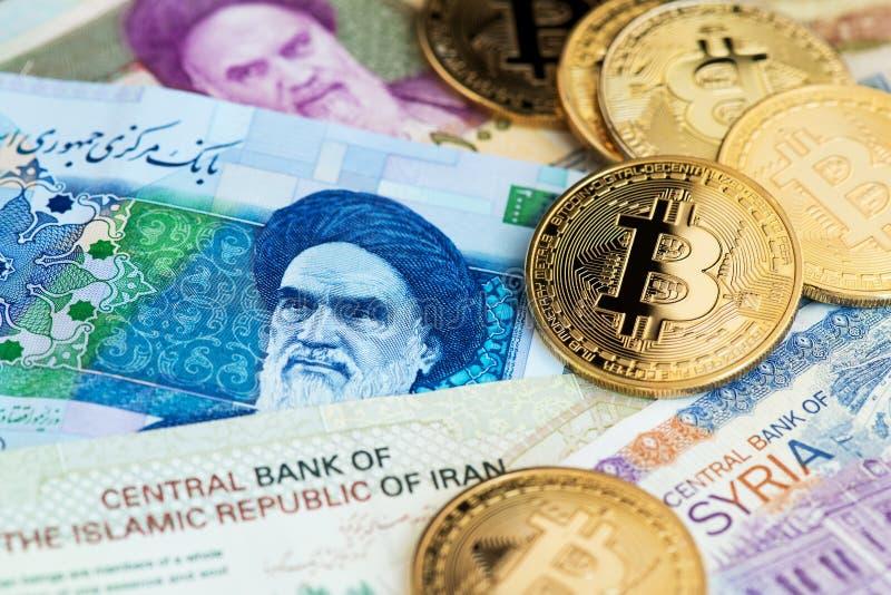 Bitcoin Cryptocurrency monety na Irańskich i Syryjskich banknotach obrazy royalty free