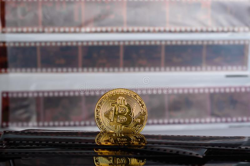 Bitcoin cryptocurrency on Exposed and Developed old film negative strips background. royalty free stock images