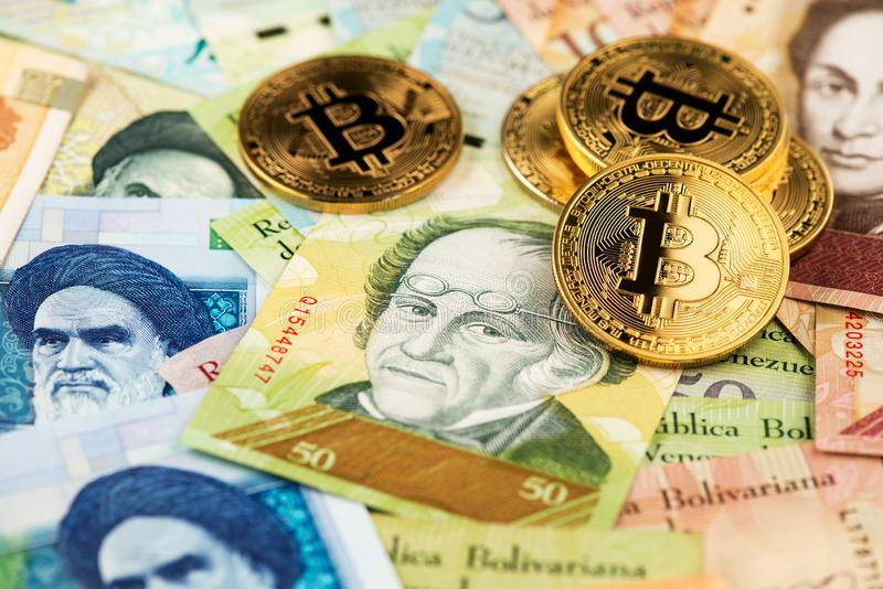 Bitcoin cryptocurrency virtual money and Iranian Rial with hyperinflation Venezuelan money Bolivar banknotes. Cryptocurrency BTC Bitcoin Blockchain Iran stock images