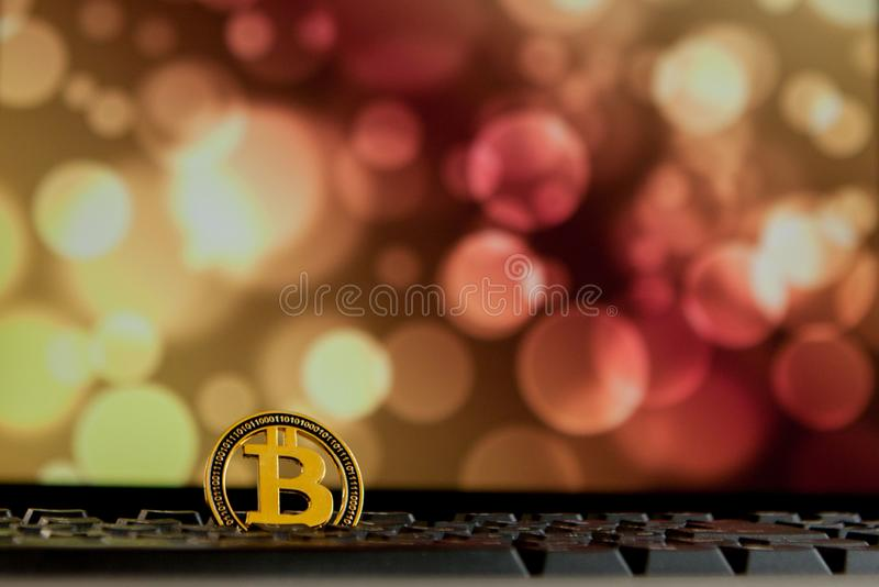 Bitcoin currency on keyboard computer on bokee background.Virtual cryptocurrency concept stock photos