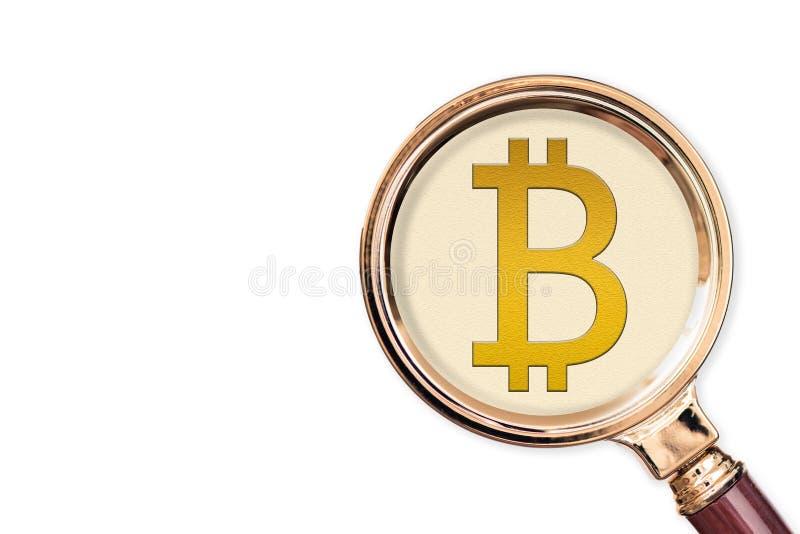 Bitcoin d'icône sous une loupe images libres de droits
