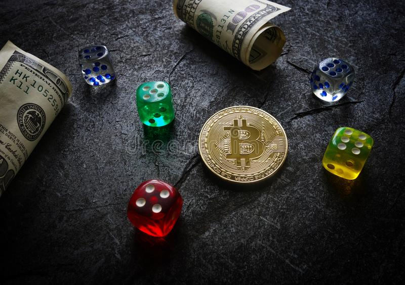 Bitcoin and dice stock photography