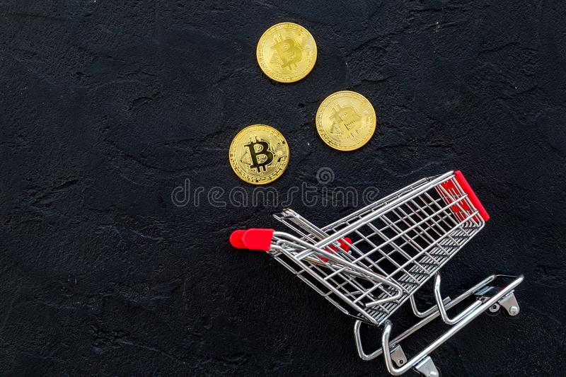 Bitcoin digital money for finance and online buy or sell and trolley black background top view mockup royalty free stock photography