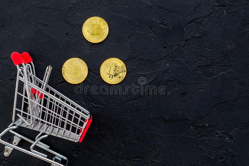Bitcoin digital money for finance and online buy or sell and trolley black background top view mockup royalty free stock images
