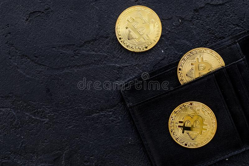 Bitcoin digital money for finance and online buy or sell and wallet black desk background top view mockup royalty free stock photography