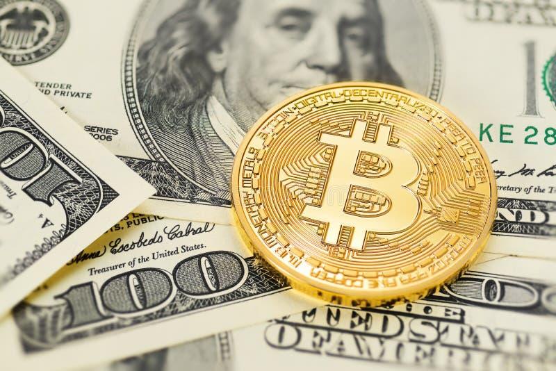 Bitcoin and dollar bills stock photography