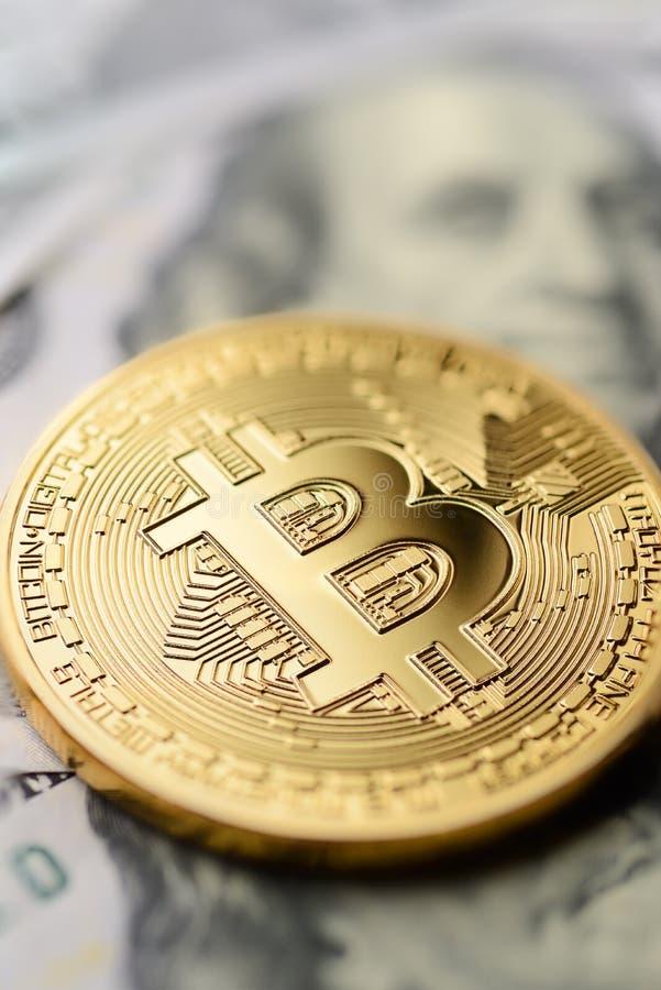 Bitcoin and dollar bills royalty free stock image