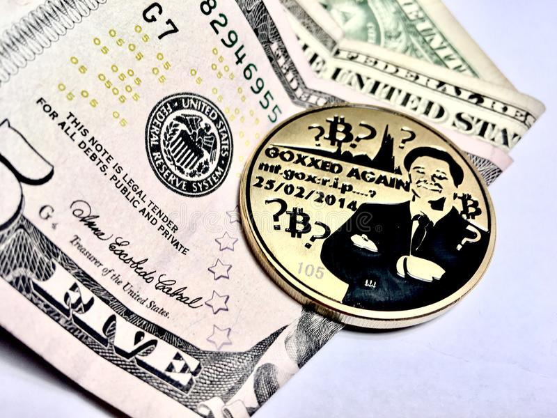 Bitcoin with a dollar stock photo