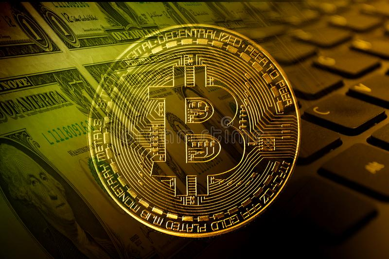 Bitcoin with dollars and keybord. Bi-color effect stock images