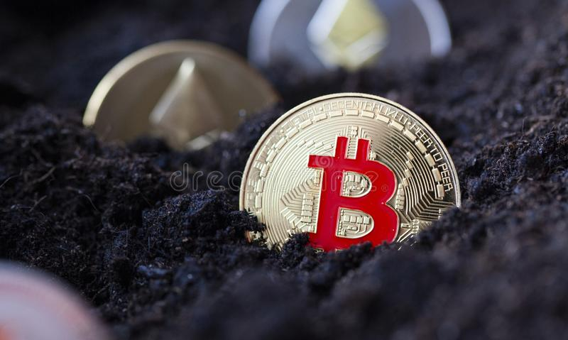 bitcoin in earth - cryptocurrency mining concept royalty free stock photography