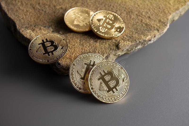 Bitcoin on the edge of a cliff single royalty free stock photography