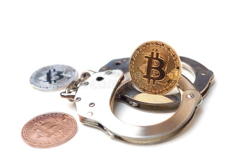 Bitcoin en las esposas foto de archivo