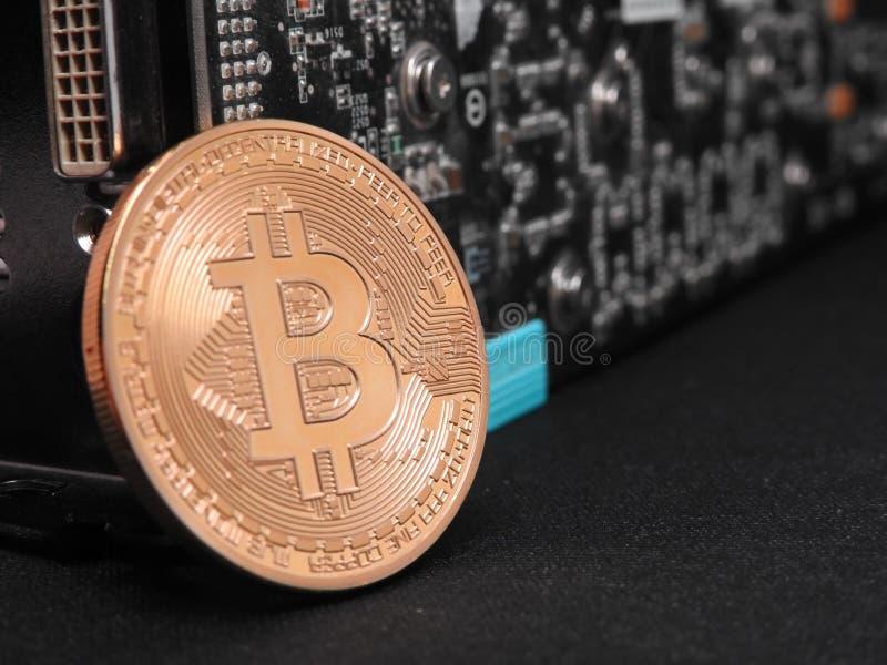 Bitcoin en unidad central de los gráficos o GPU fotos de archivo libres de regalías