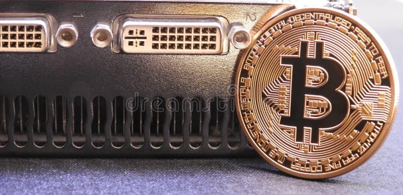 Bitcoin en unidad central de los gráficos o GPU imagenes de archivo