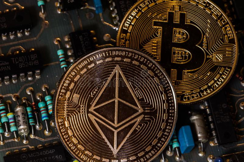 Bitcoin and ethereum coin on circuit board. Bitcoin and ethereum coin on circuit stock images