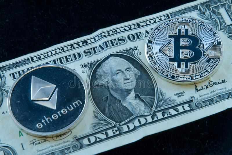 Bitcoin ethereum crypto currencies concept coins and dollar bill royalty free stock image