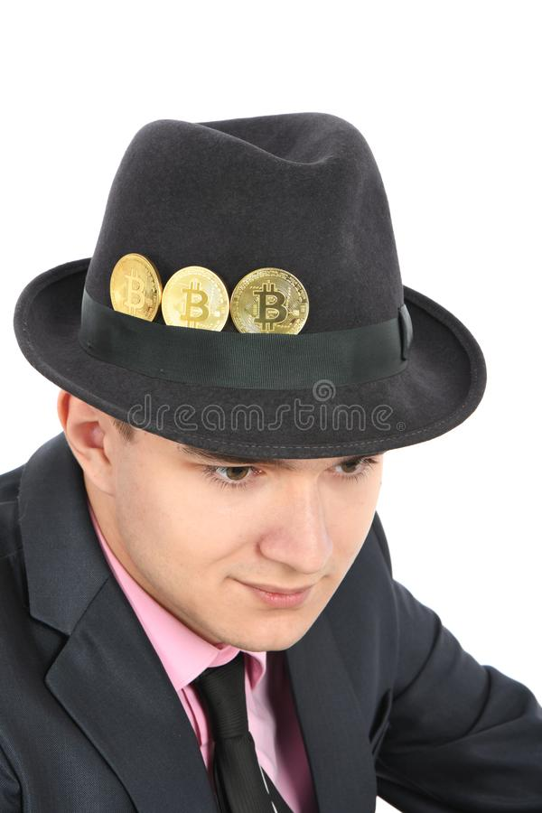 Bitcoin in a felt men`s hat isolated on white royalty free stock photography