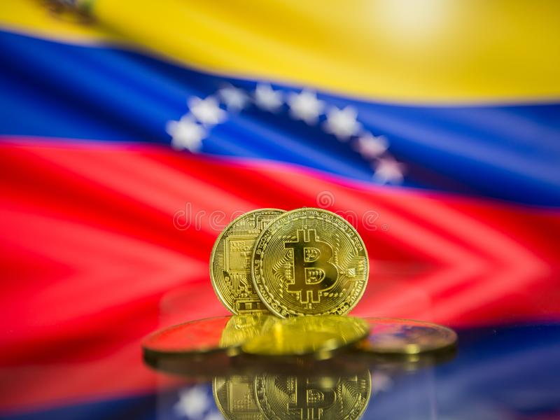 Bitcoin gold coin and defocused flag of Venezuela background. Virtual cryptocurrency concept. stock images