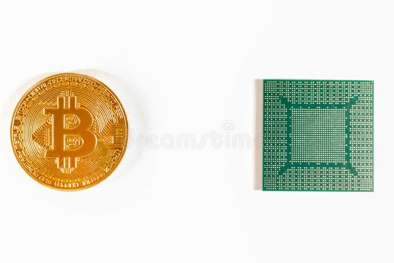 Bitcoin gold coin and video chip. Crypto currency stock photography