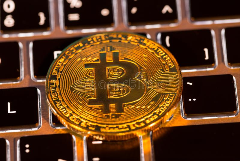 Bitcoin gold coins with laptop keyboard. Virtual cryptocurrency concept. royalty free stock photography