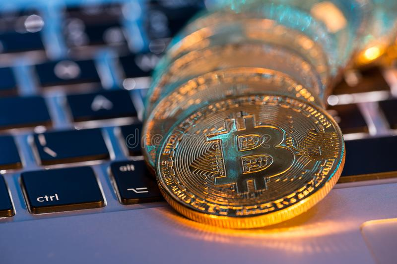 Bitcoin gold coins with laptop keyboard. Virtual cryptocurrency concept. royalty free stock photo