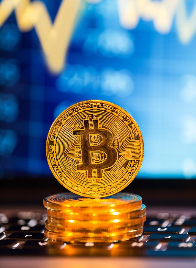 Bitcoin gold coins with laptop keyboard. Virtual cryptocurrency concept. royalty free stock photos