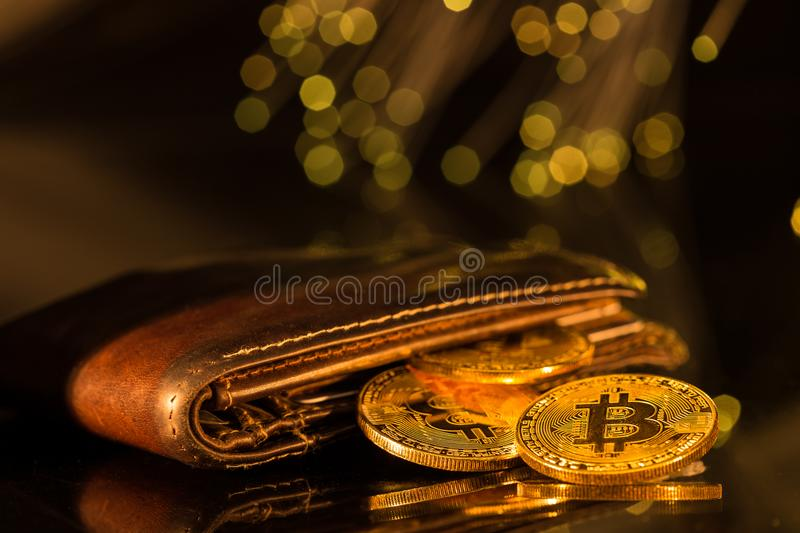 Bitcoin gold coins with wallet. Virtual cryptocurrency concept. royalty free stock photo